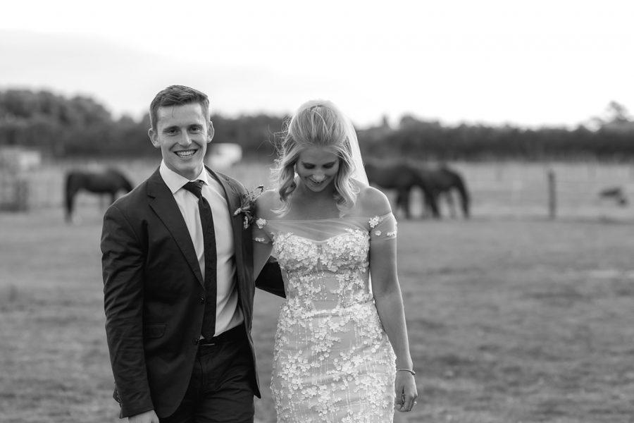 Rustic country wedding walking laughing