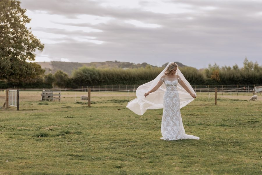 Country boho bridal dress with veil flowing