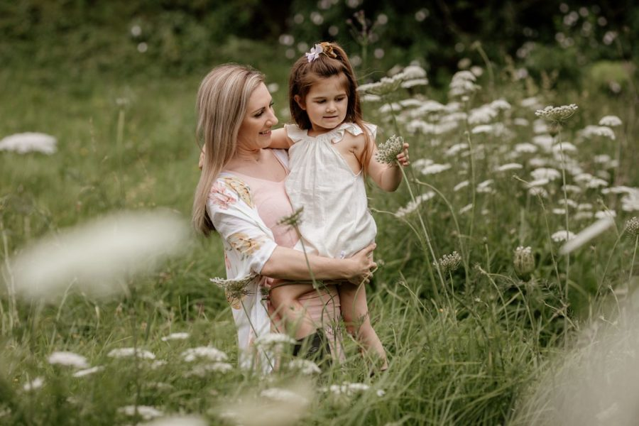 country setting natural family photo with little girl and aunt