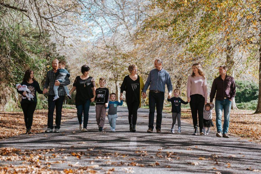 Autumn family walking along road