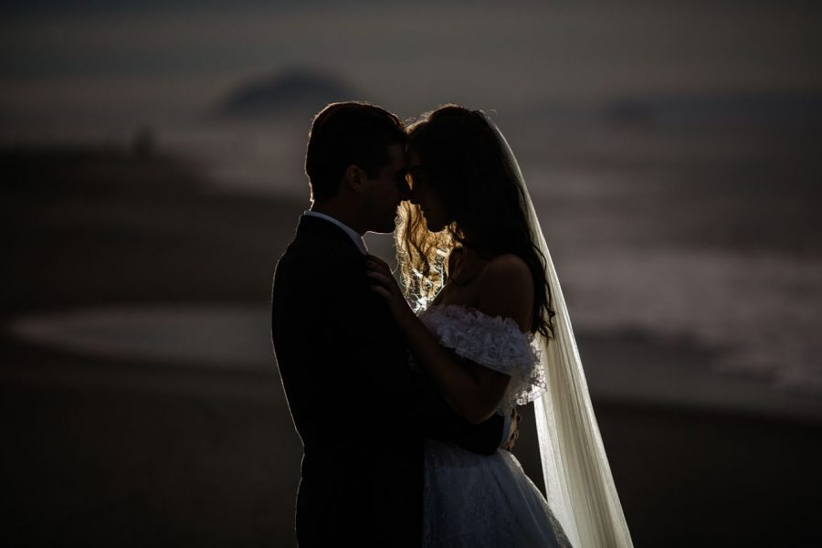 Nighttime beach shot of bride and groom