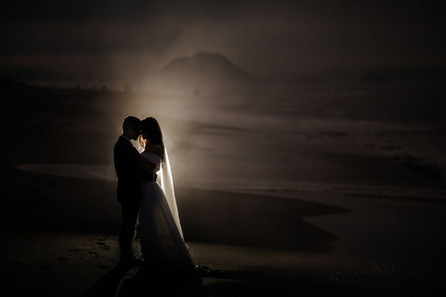 Sea spray landscape photo of bride and groom