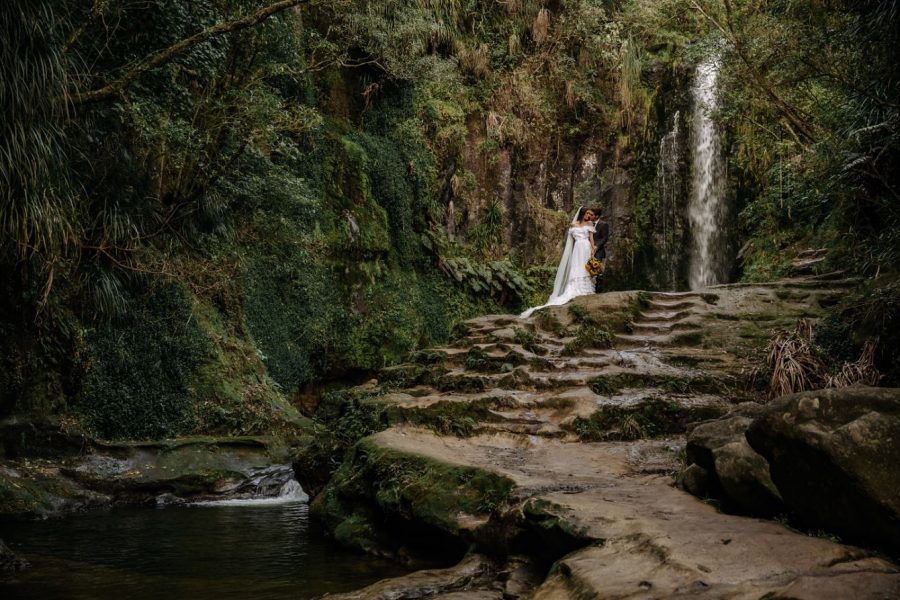 Waterfall wedding picture surrounded by natural NZ bush
