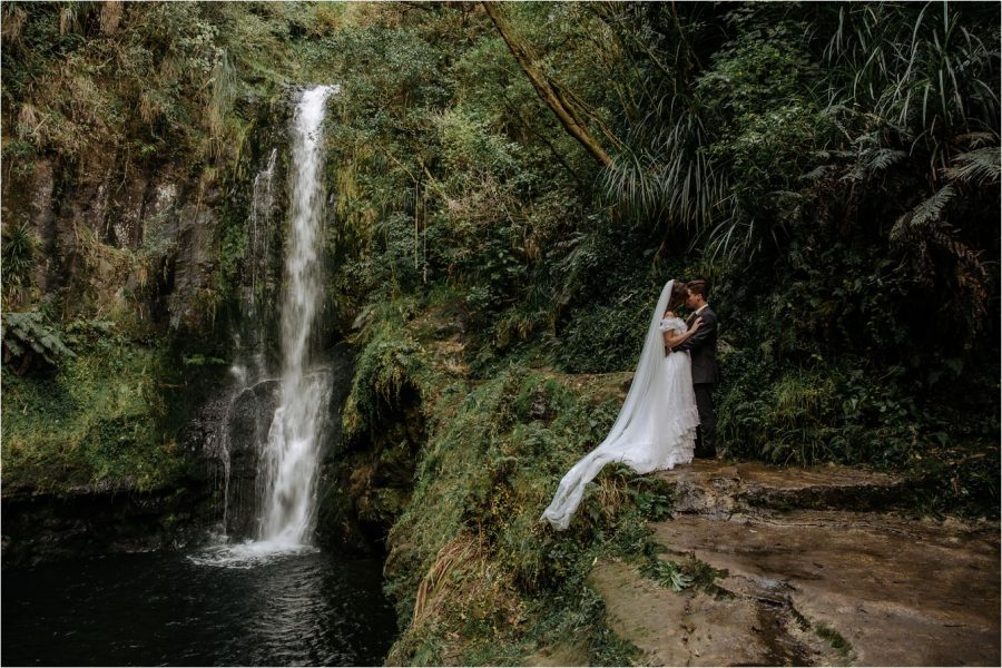 Landscape wedding photo of Kaiate Falls