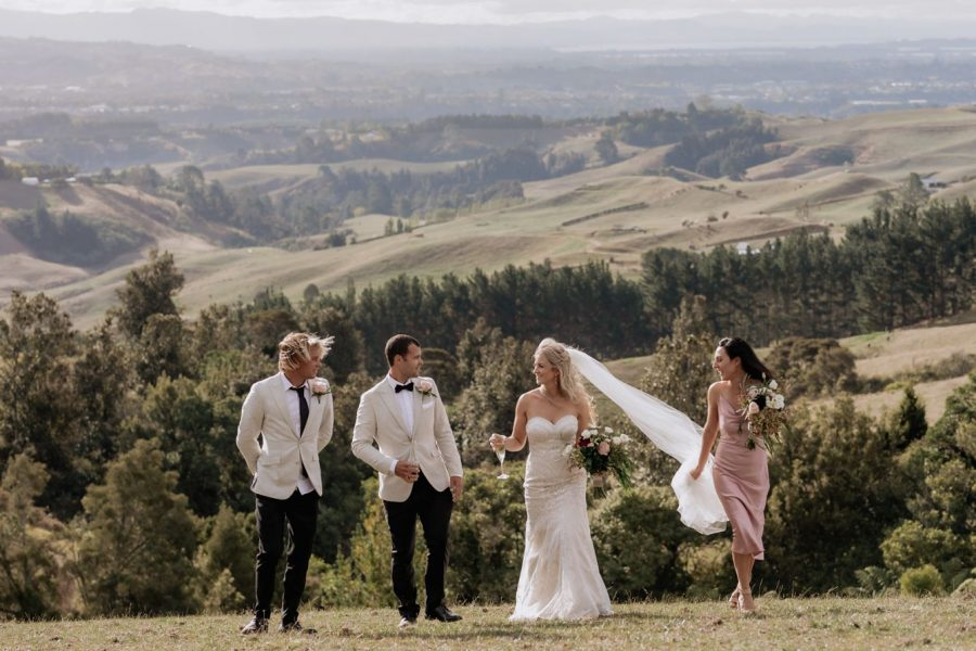 Wedding party laughing in the hills