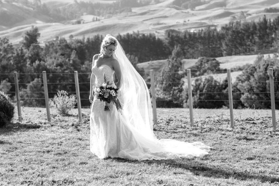 Bride looking down at veil