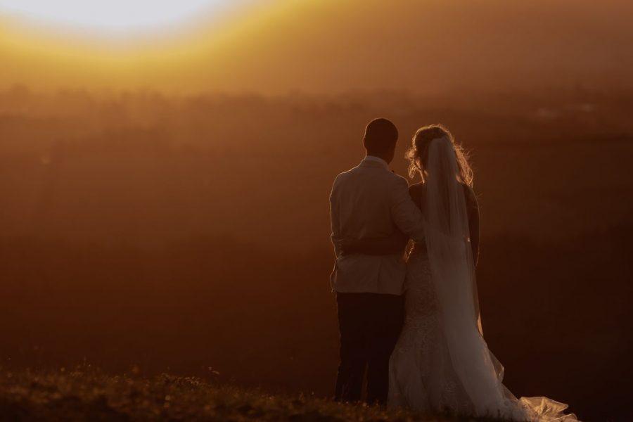bride and groom enjoying golden hour
