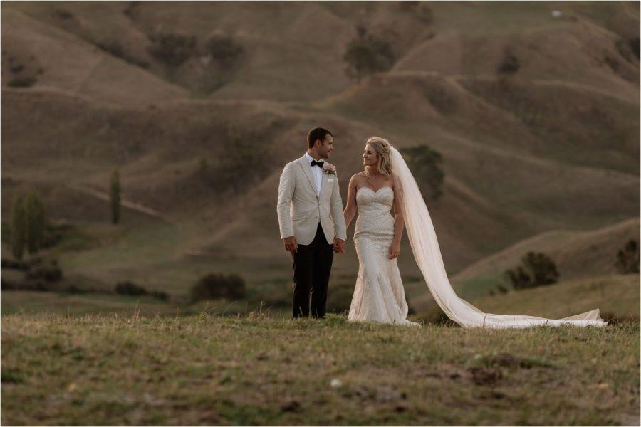Wedding couple walking the hills