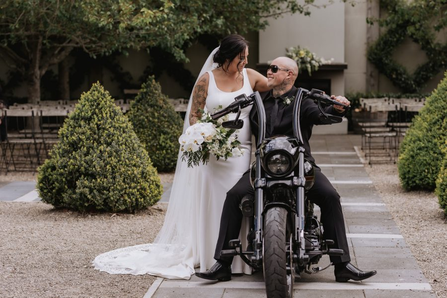 Bride and groom on Harley Davidson motor bike at Ataahua garden ceremony area