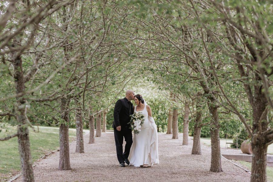 Beautiful moment between bride and groom Ataahua pear Trees