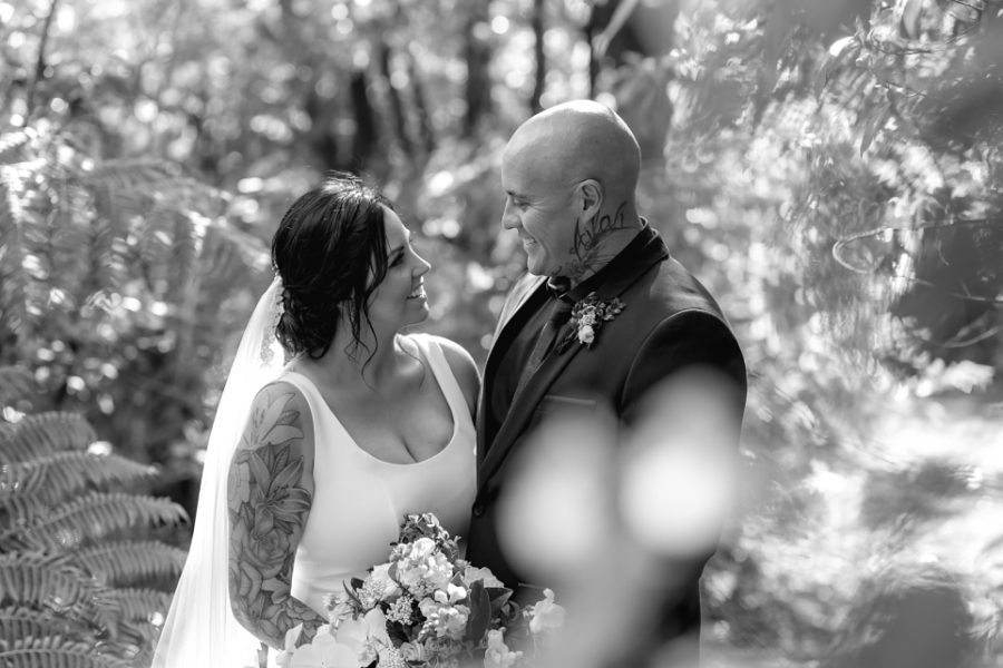 Candid moments in the bush in NZ Wedding