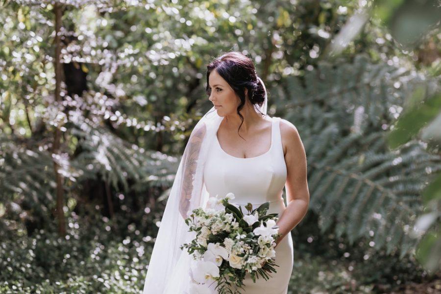 Bridal portraits of Bride in native new Zealand bush