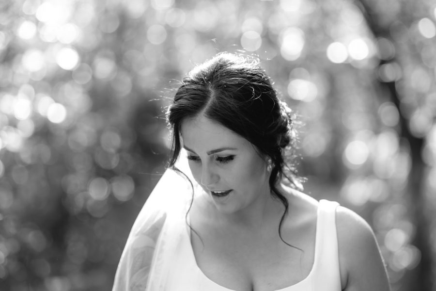 Candid natural moment of bride in garden