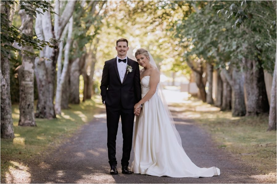 Beautiful classic wedding photo of bride and groom on driveway in Bethlehem Tauranga New Zealand