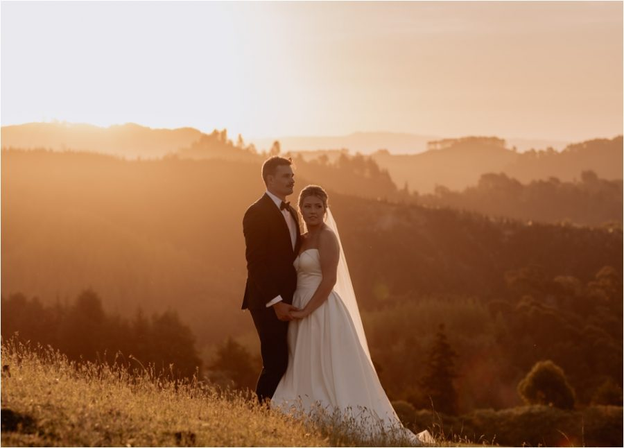 Golden hour wedding portraits with couple on hills in country scene
