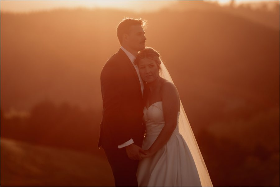 Beautiful intimate moment captured of bride and groom at sunset