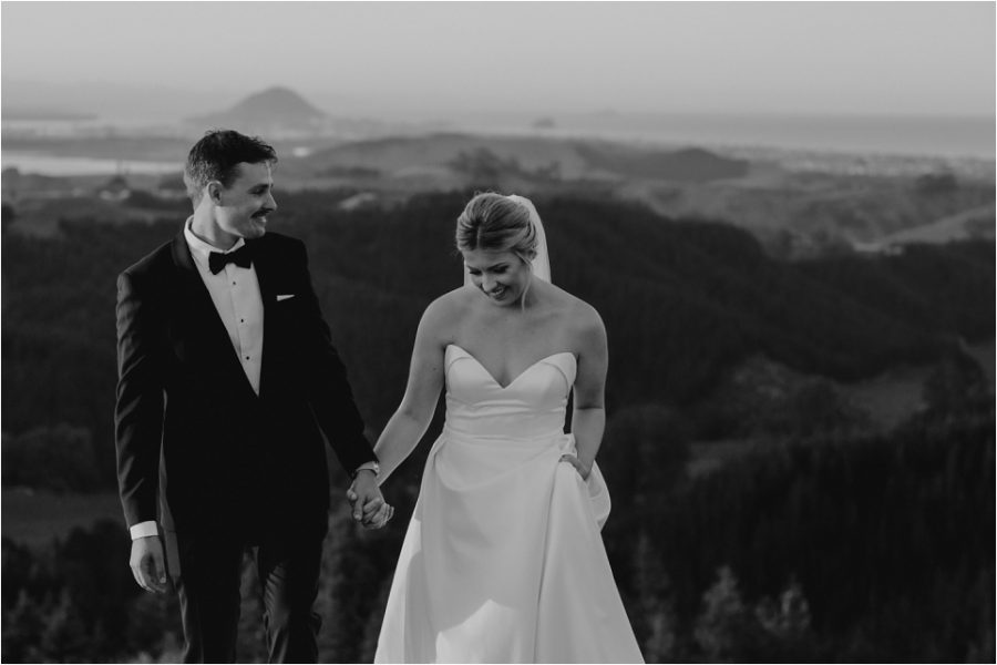 Moody vibe photo country side photo with bridal couple walking on hills