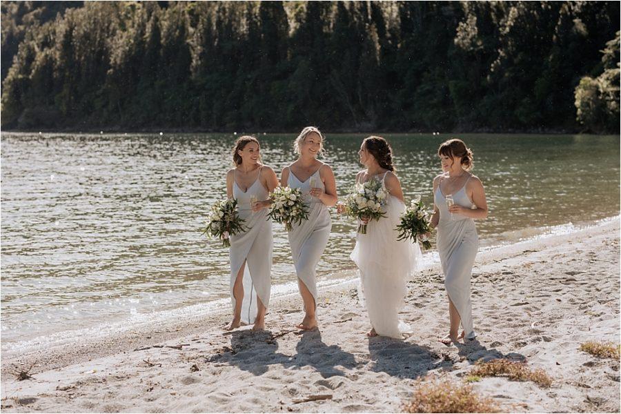 Walking bridesmaids laughing