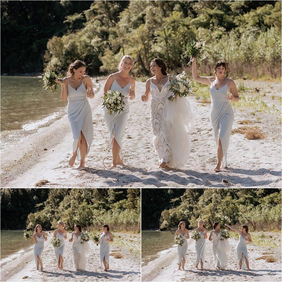 Green bridal party girls walking along beach having fun