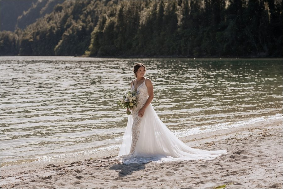 Bride in front of green lake