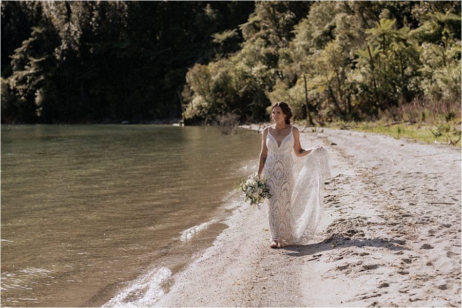 Bride walking along lake front at Okataina New Zealand