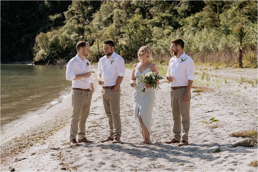 Groom with his grooms men and woman on the lake front