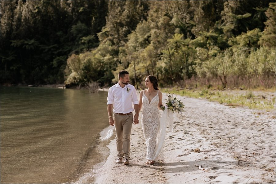 Happy couple walking on lake front