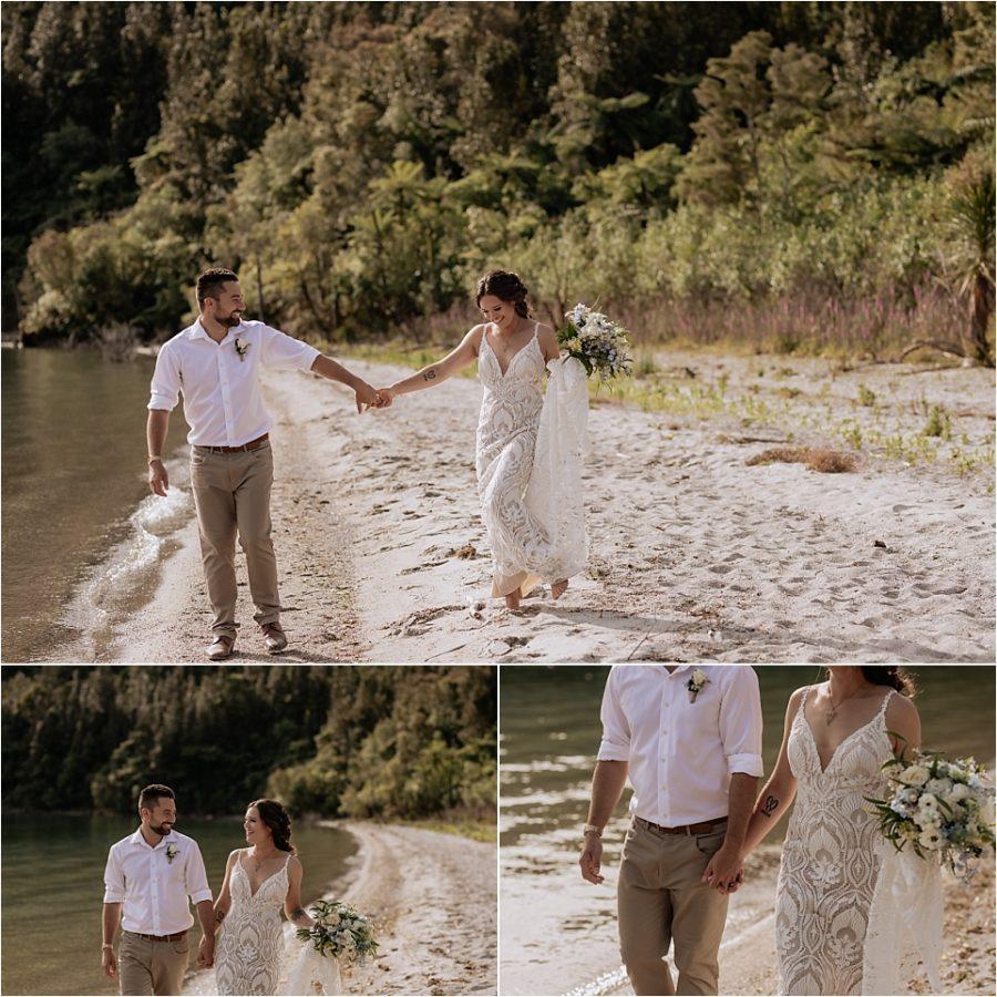 Bride and groom walking laughing along lake shore