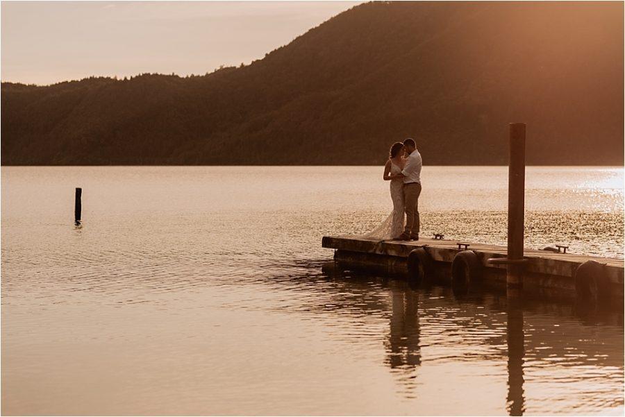 Sunset photos on Lake Okataina of bridal couple