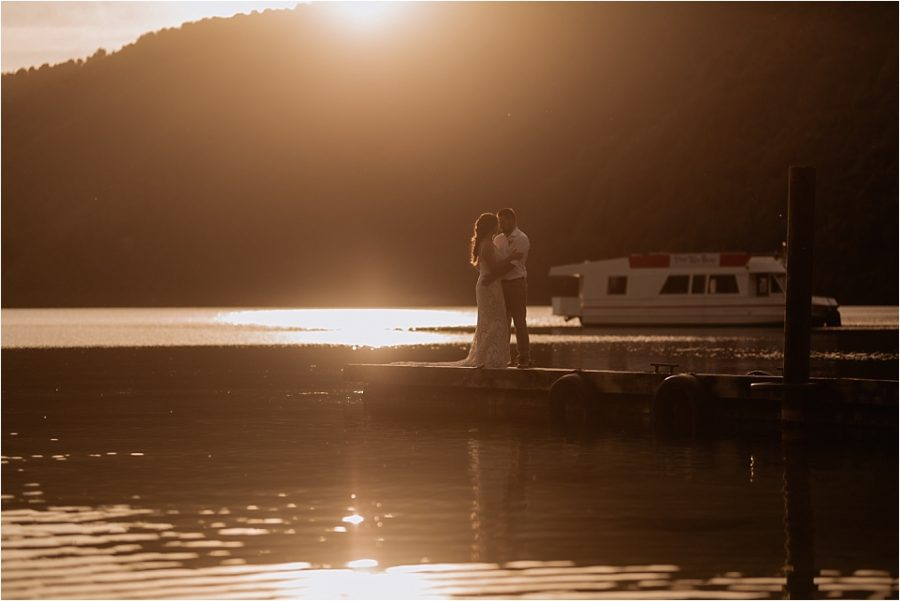 Wedding photos of golden hour with the sun and water glistening