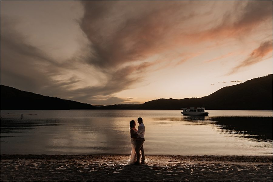 Bride and groom at night with beautiful sky