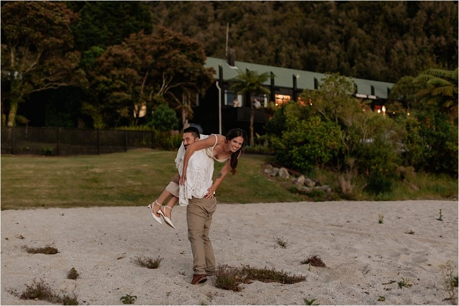 Groom carrying bride back to lodge
