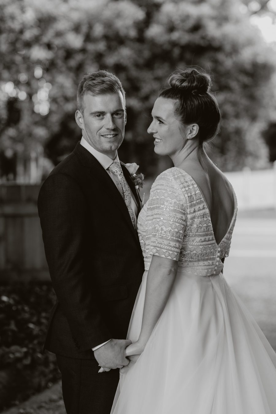 Black and white with bridal couple on driveway