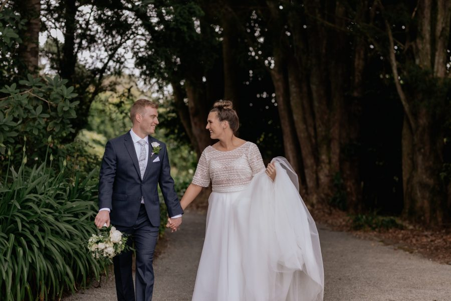Bride and groom walking on a country lane