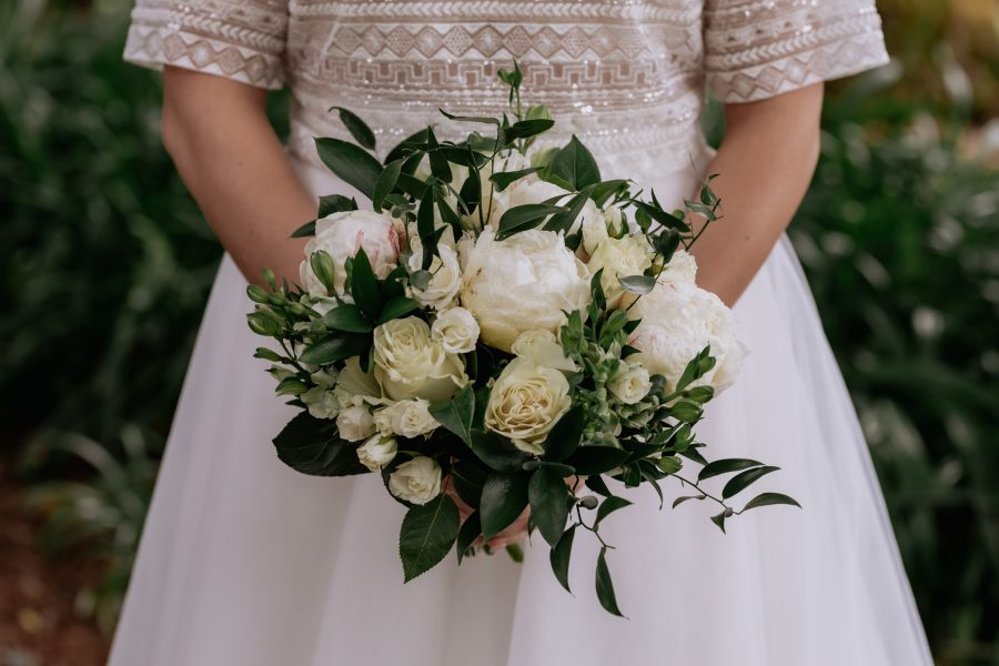 Bride with bouquet green and cream