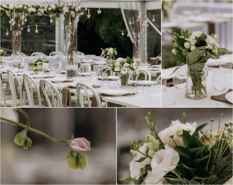 Flower arrangements and table settings for wedding reception inside marquee