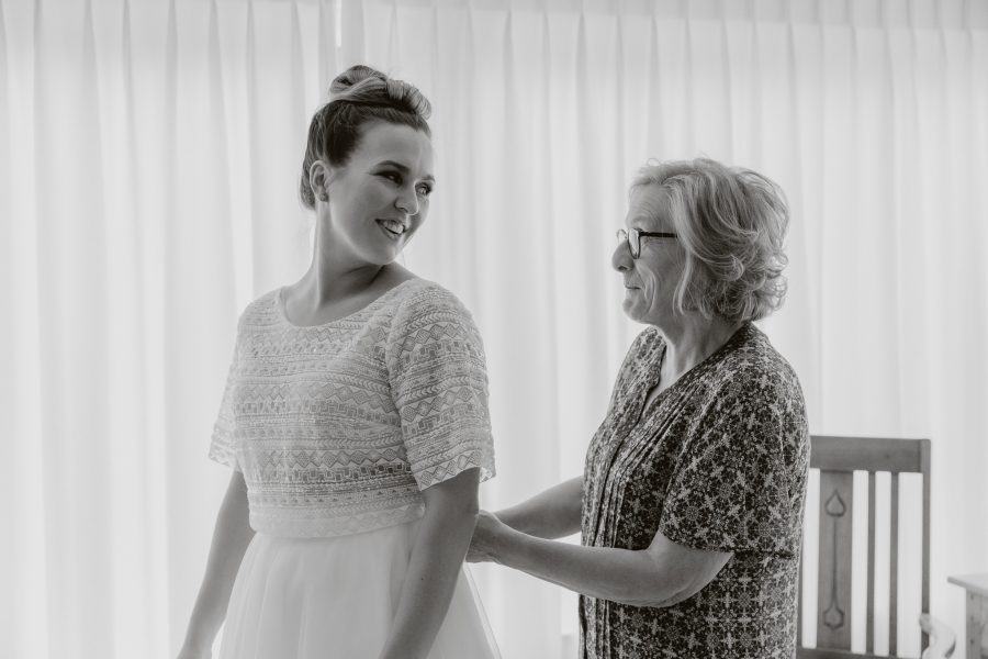 Bride and mother of bride getting ready