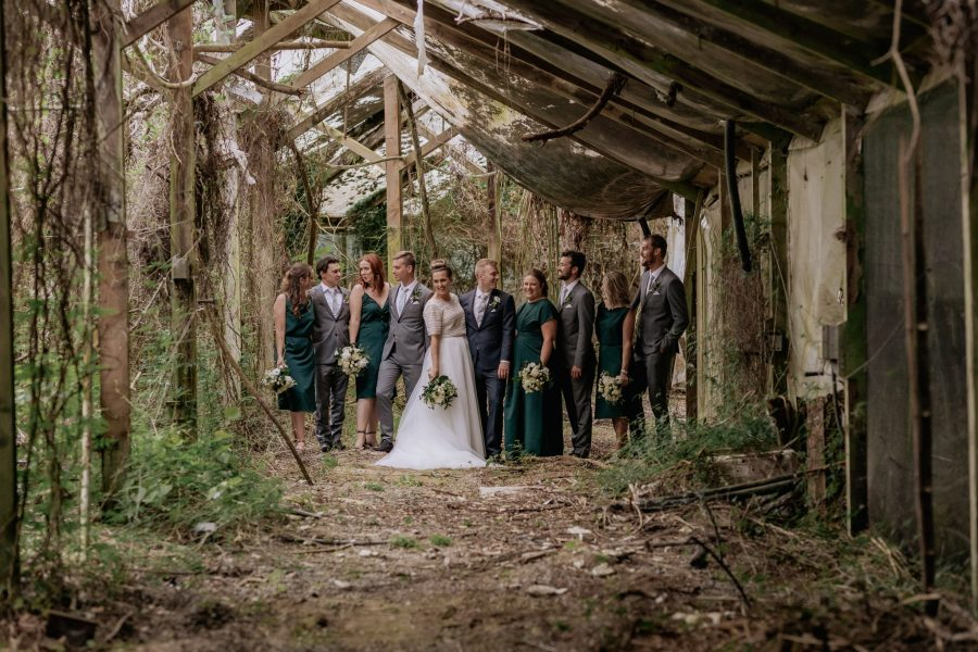 Bridal party in old abandoned glasshouse
