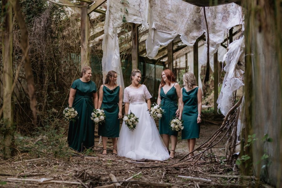 Bridesmaids with bride in abandoned old building