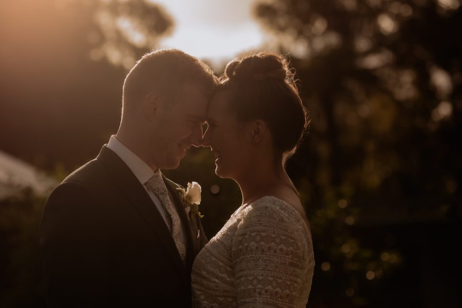 Low golden moody light with bride and groom