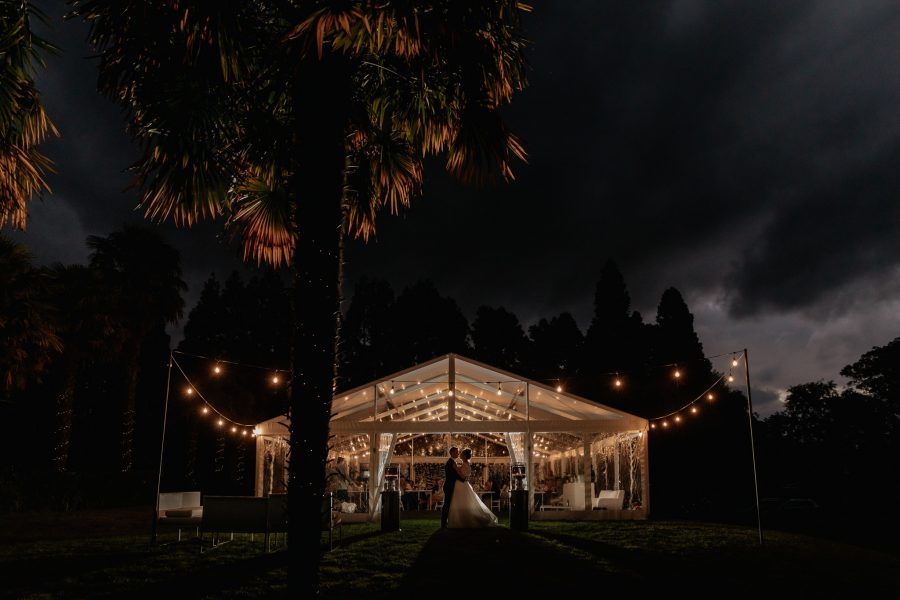 Wedding marquee at back yard wedding at night time in Tauranga