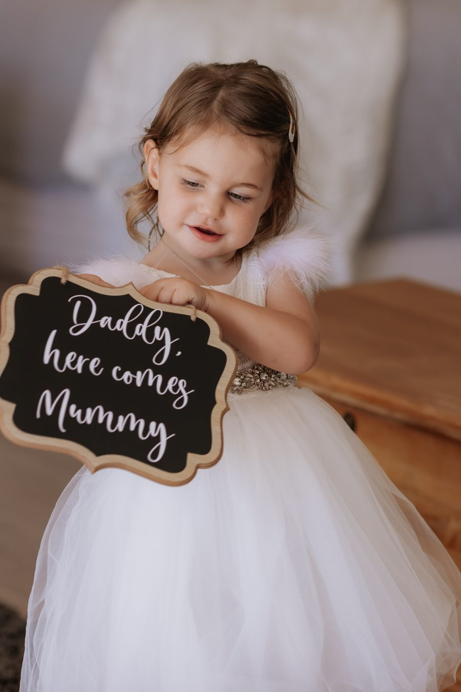 Flowergirl with Daddy here comes Mummy sign