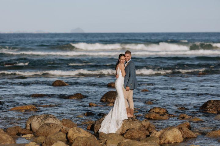 Wedding photography on the rocks at Orua Beach house