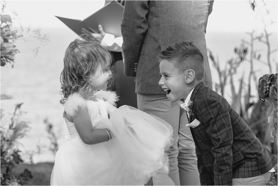 Page boy laughing with flower girl