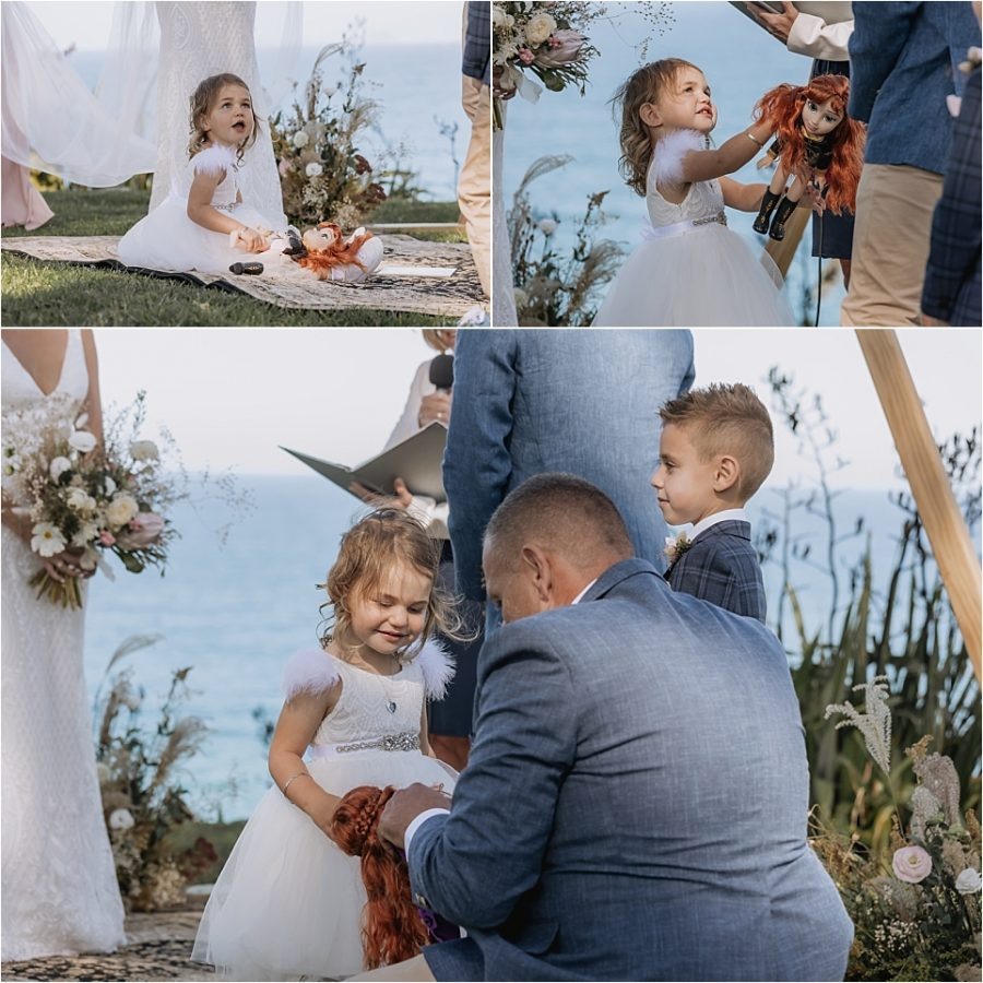 Best man helps flower girl with her doll