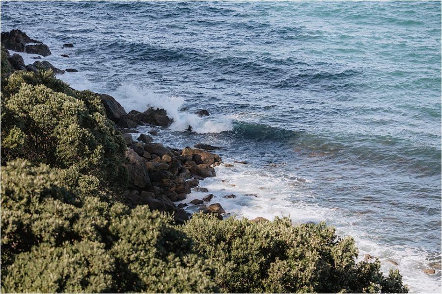 Sea crashing on rocks while ceremony in progress