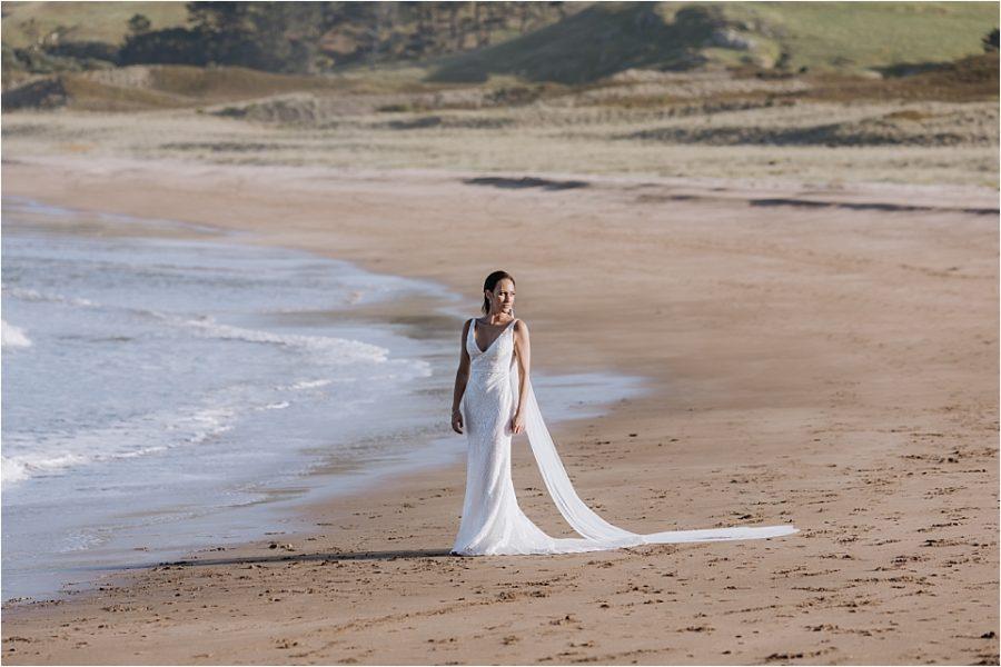 Wedding photo of bride on beach