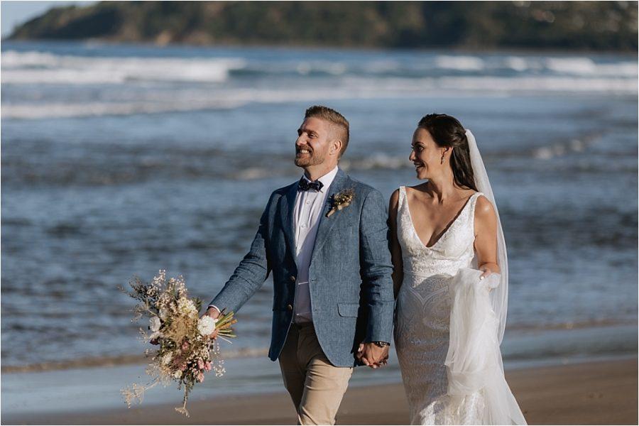 Happy natural candid wedding photos at Hot Water Beach NZ