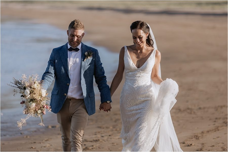 Moments between bride and groom on Hot Water Beach with Pure Images Photography