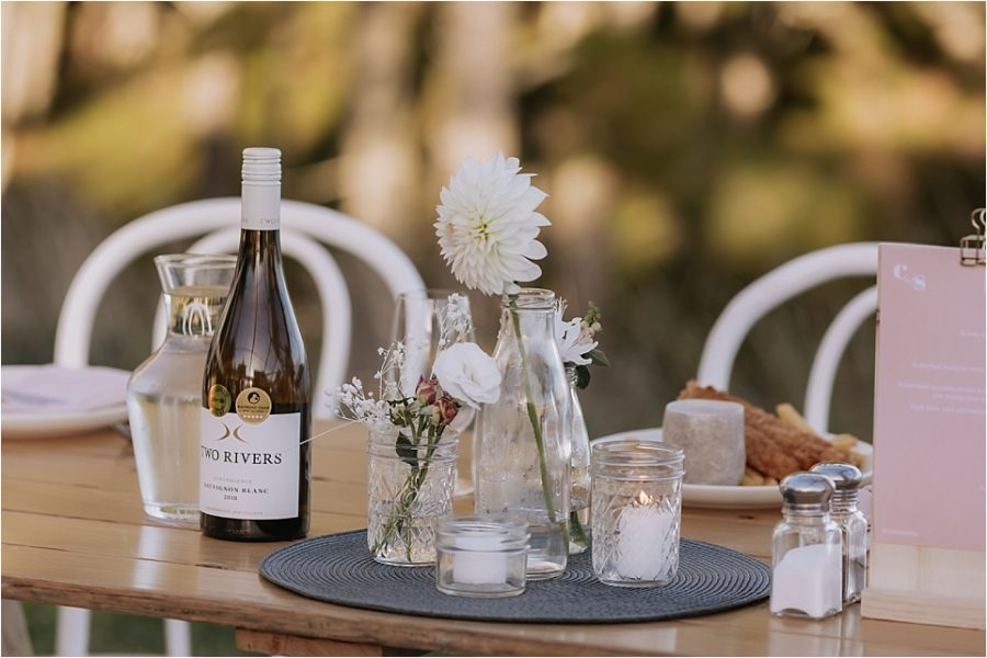 Orua beach house wedding reception table details